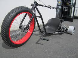 this drift trike has a heavy duty tubular steel frame with a 65 horsepower engine connected to metal banded rear go kart tires for maximum powerful - Drift Trike Frame