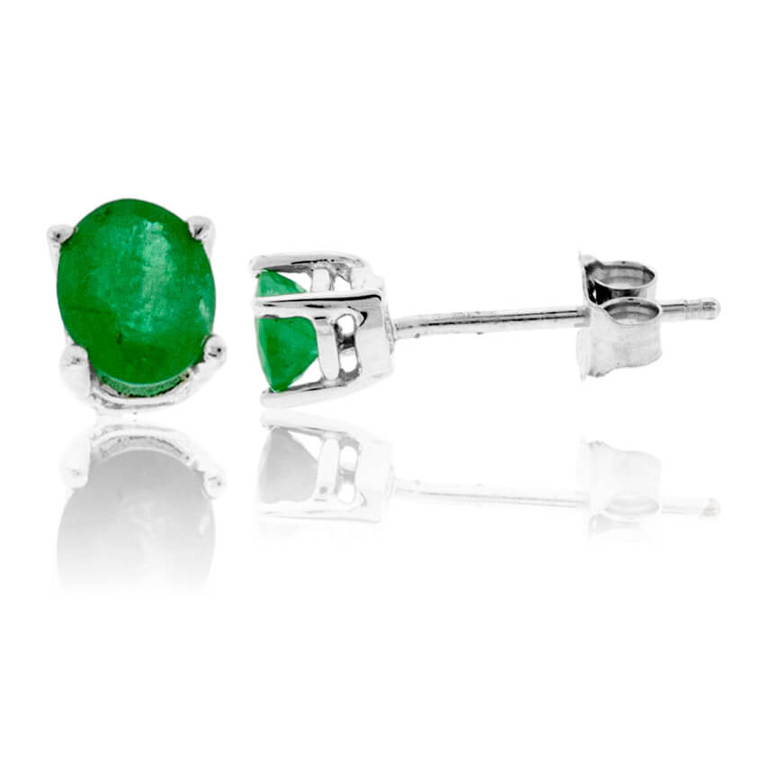 Oval Shaped Emerald White Gold Stud Earrings