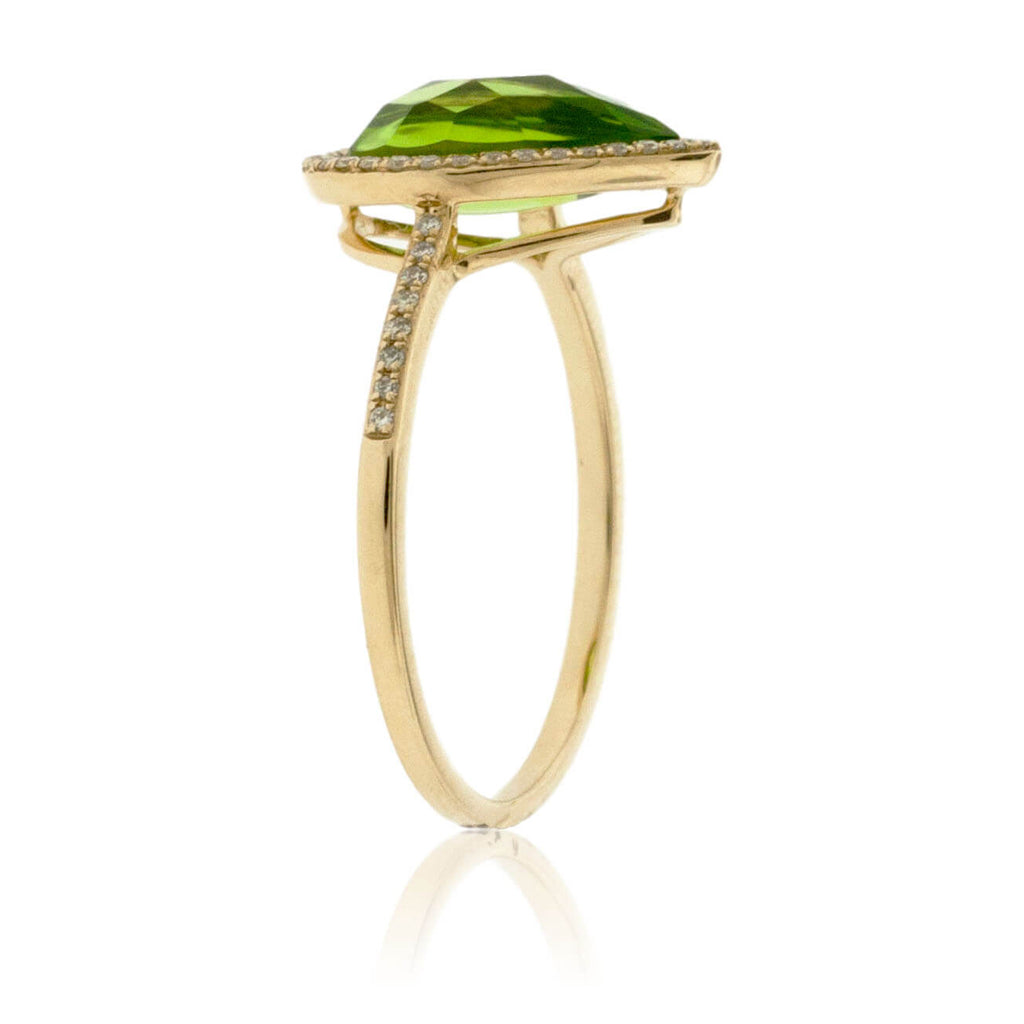 Pear Shaped Peridot with Diamond Halo on Diamond Accented Band