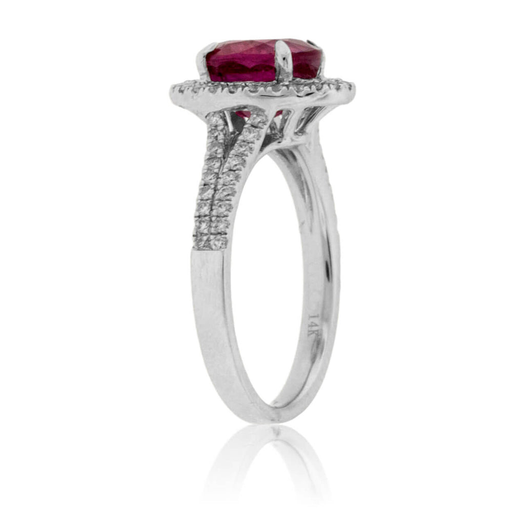 Oval Ruby and Split Shank Diamond Halo Ring