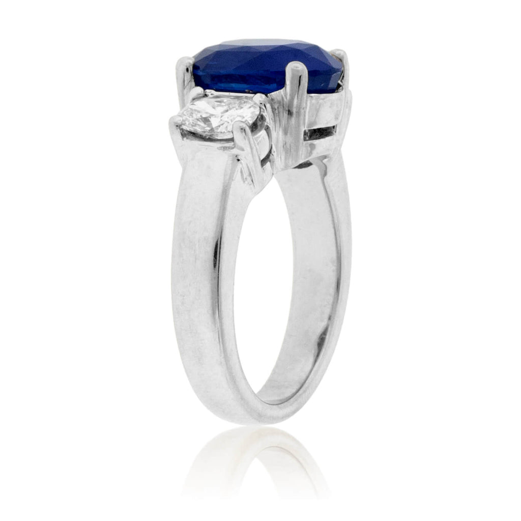 Oval Blue Sapphire & Diamond Three Stone Ring