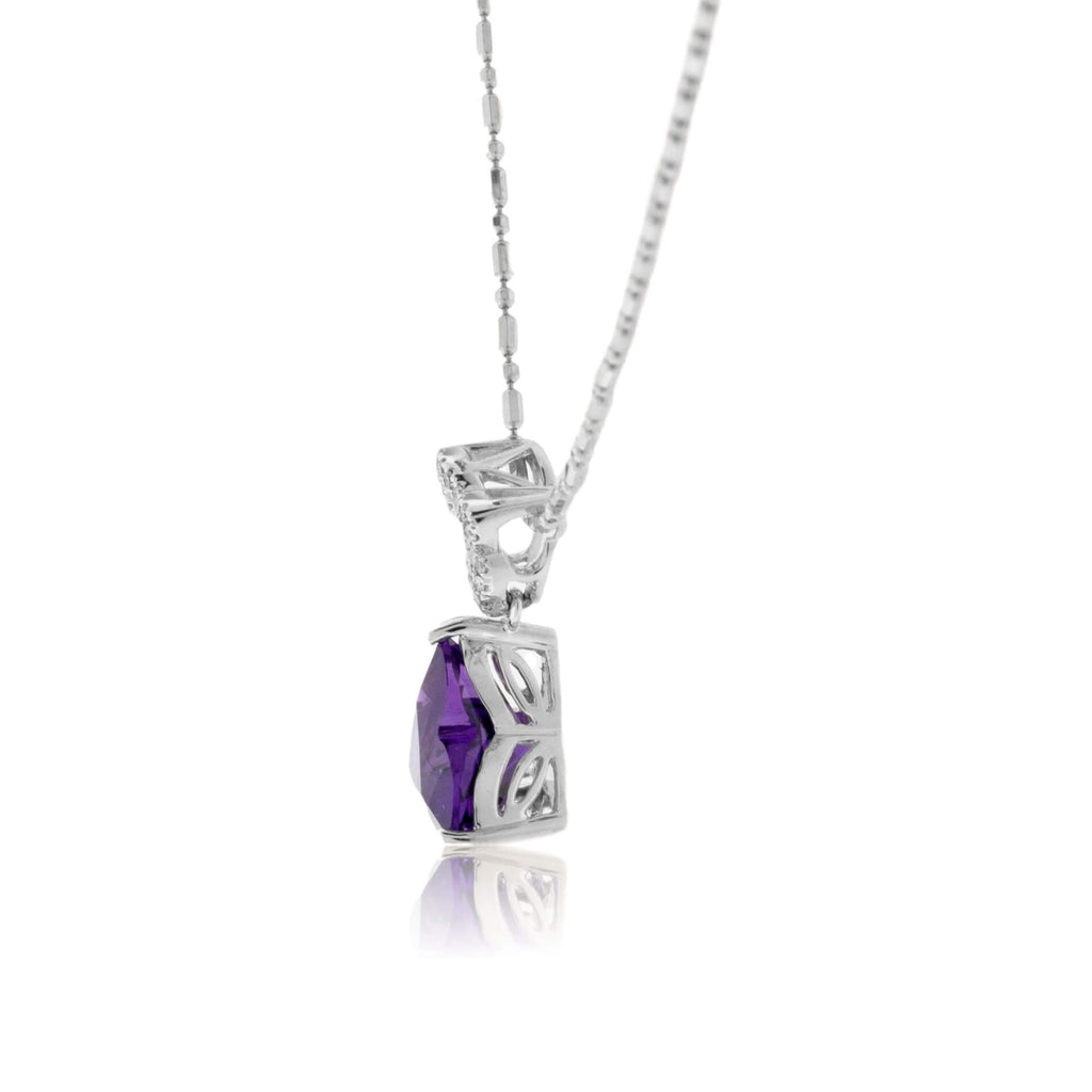 Carved Amethyst and Diamond Pendant