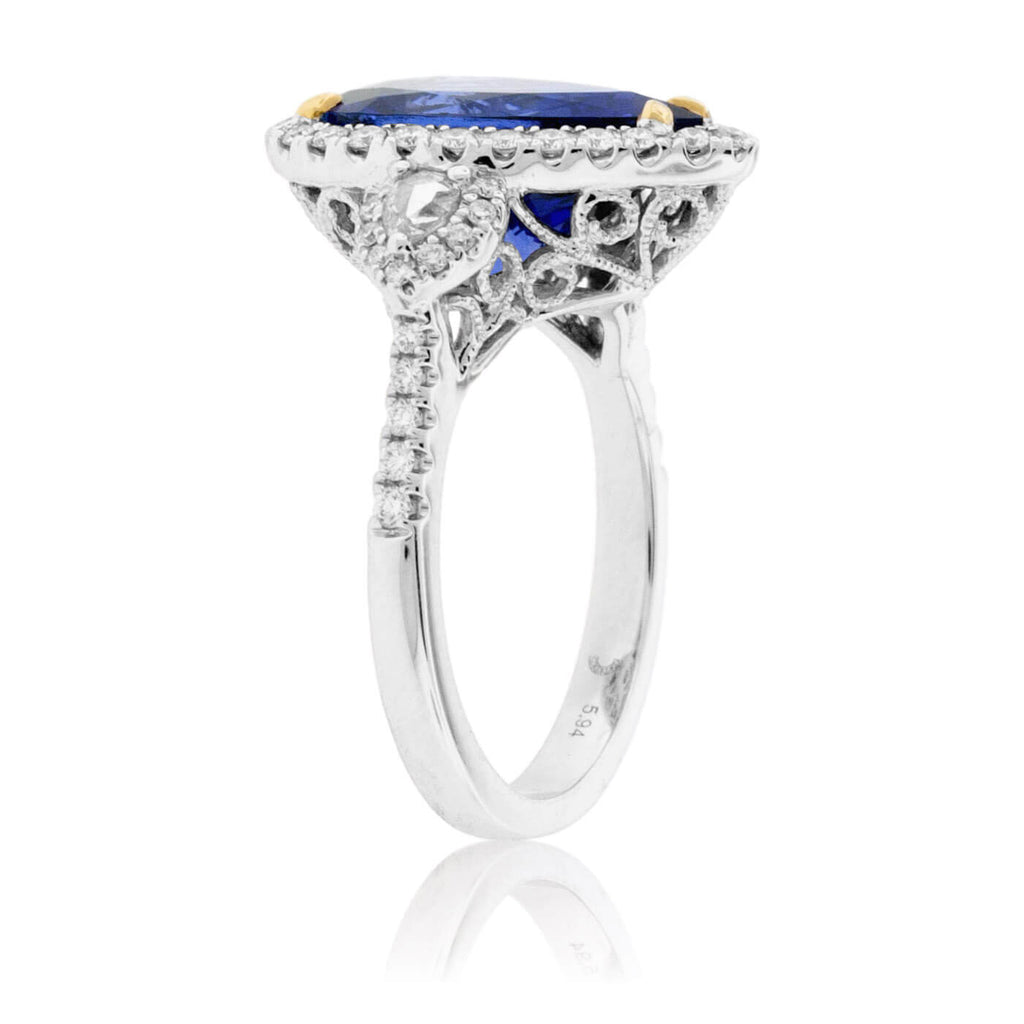 Pear-Shaped Tanzanite and Diamond Halo Ring
