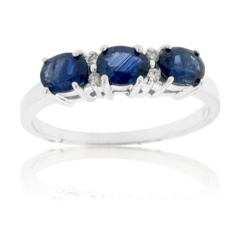 Blue Sapphire Three Stone Oval to the Side Ring