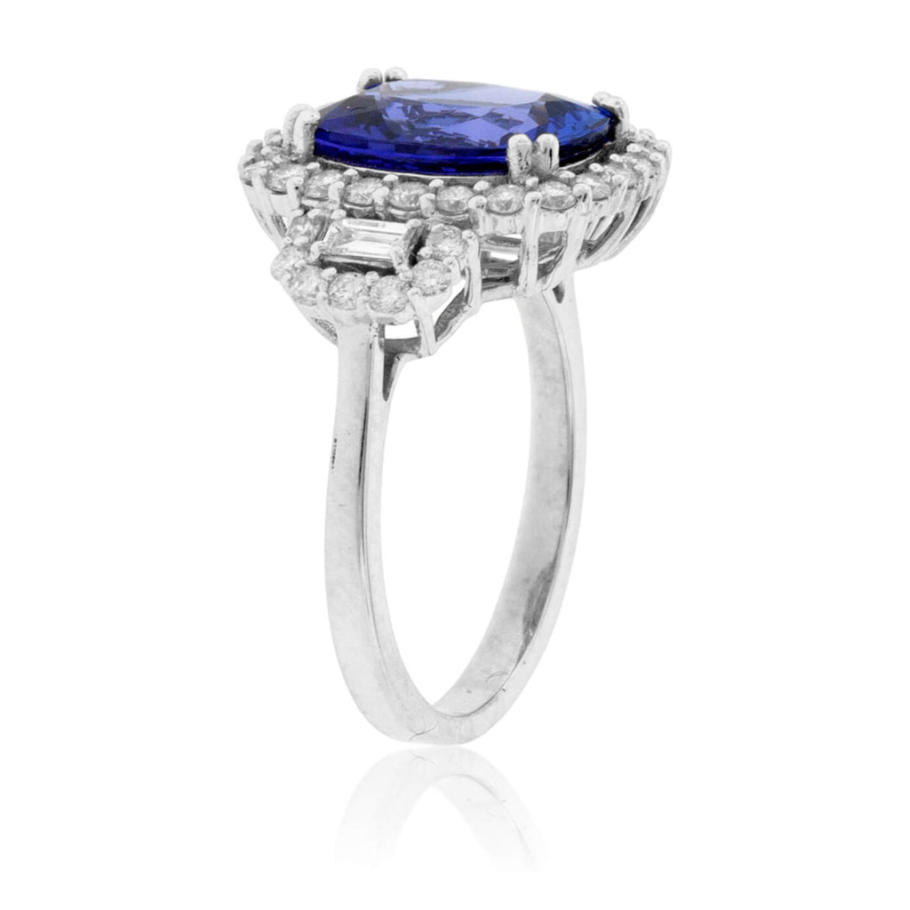 Cushion-Cut Tanzanite and Diamond Halo Three Stone Ring