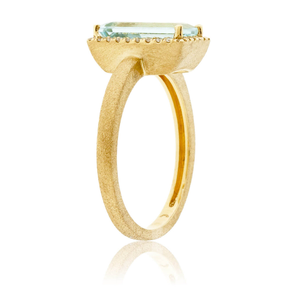 Baguette-Cut Aquamarine in Yellow Gold with Diamond Halo Ring