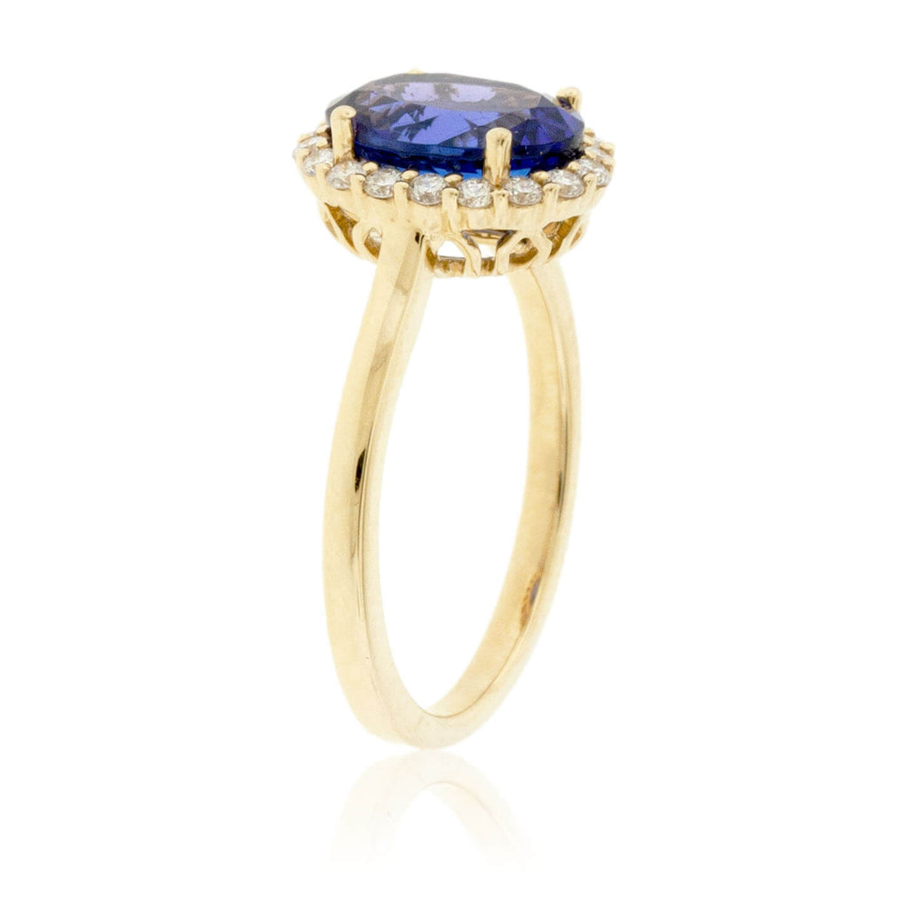 Oval Tanzanite & Diamond Halo Yellow Gold Ring