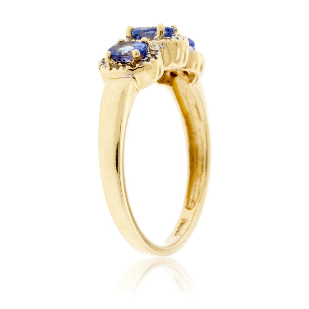 Three Stone Tanzanite with Diamond Halo Ring