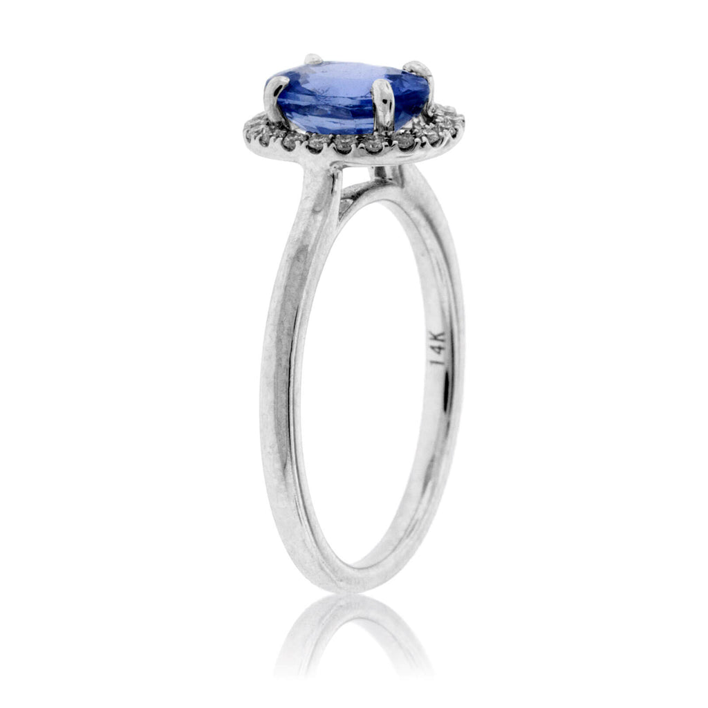 Oval Tanzanite and Diamond Halo Ring