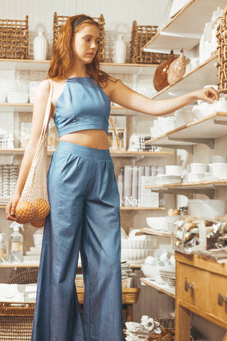 girl wearing sage the label untamed hearts set shopping in kitchen store