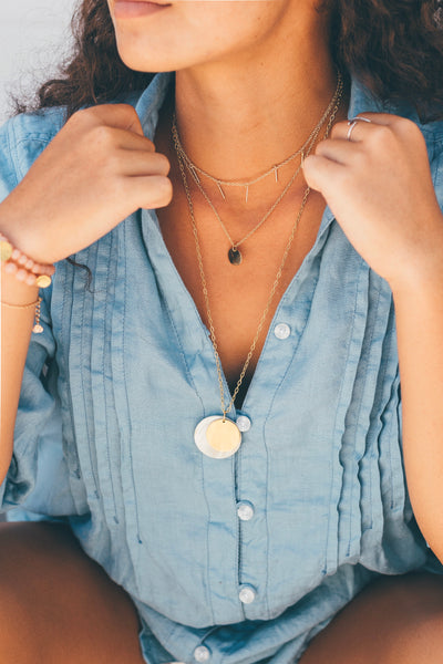 layering handmade jewelry available at cote boutique