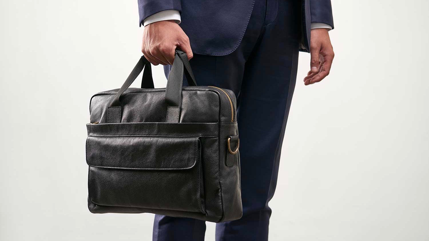 man-carrying-leather-briefcase