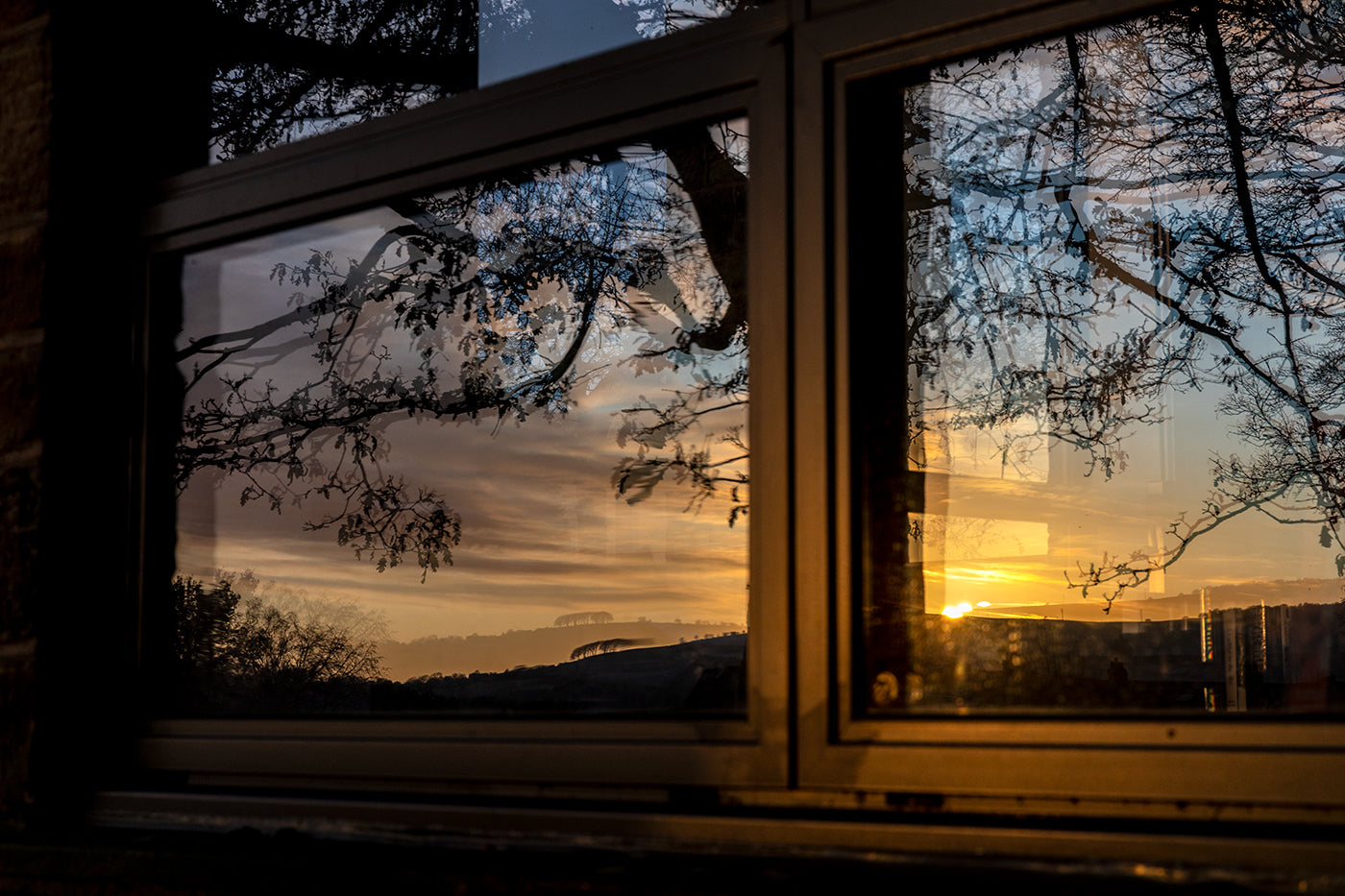 Sunset reflected in library window, burley in wharfedale
