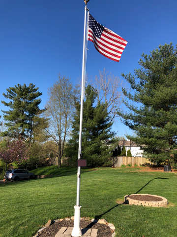 20' flagpole in backyard without plant