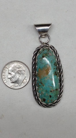 Natural untreated Burtis Blue Turquoise and sterling silver pendant