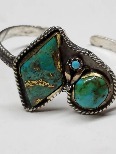 Unstabilized turquoise, diamond, gold and sterling silver bracelet