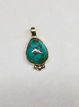 Untreated turquoise and gold pendant