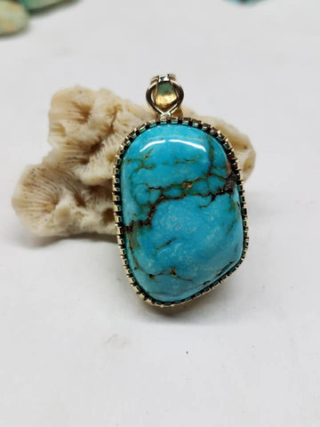 14 k gold and turquoise pendant