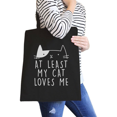 Image of at least my cat loves me black totebag