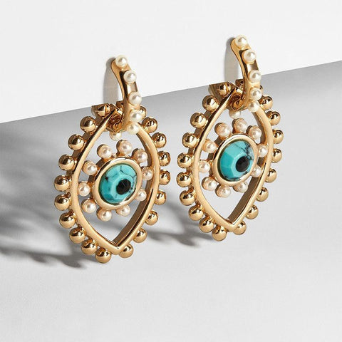 Image of gold and blue pierced earrings