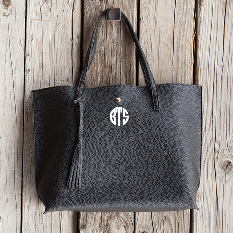 Image of black vegan leather purse monogram