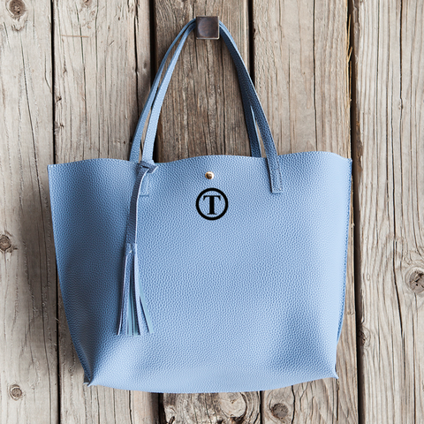 Image of blue vegan leather bag with monogram