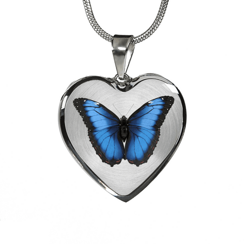 Image of Blue butterfly heart shaped necklace