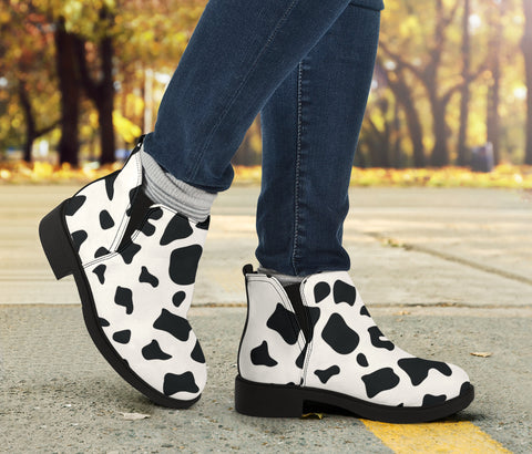 Image of faux cowhide vegan suede fashion boots