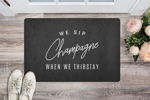 Sip Champagne Gray Welcome Mat