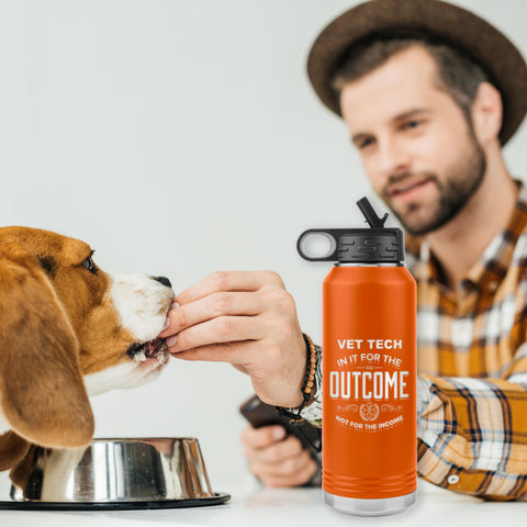 Image of mand and dog with a vet tech appreciation etched stainless steel orange water bottle