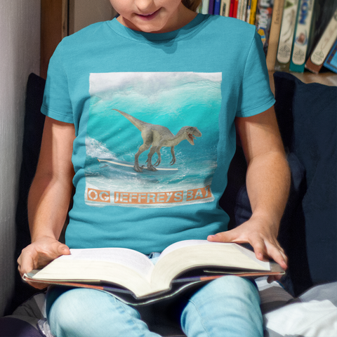 dinsaur surfing graphic kids shirt
