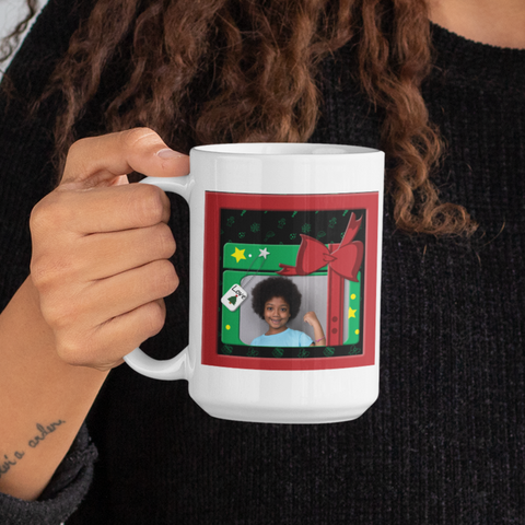 Image of woman holding personalized photo mug for christmas