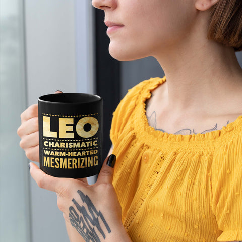 Image of woman holding a leo astrology horoscope quote black mug