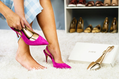 Insert Forme into shoes to stretch toe area of uncomfortable pink shoes