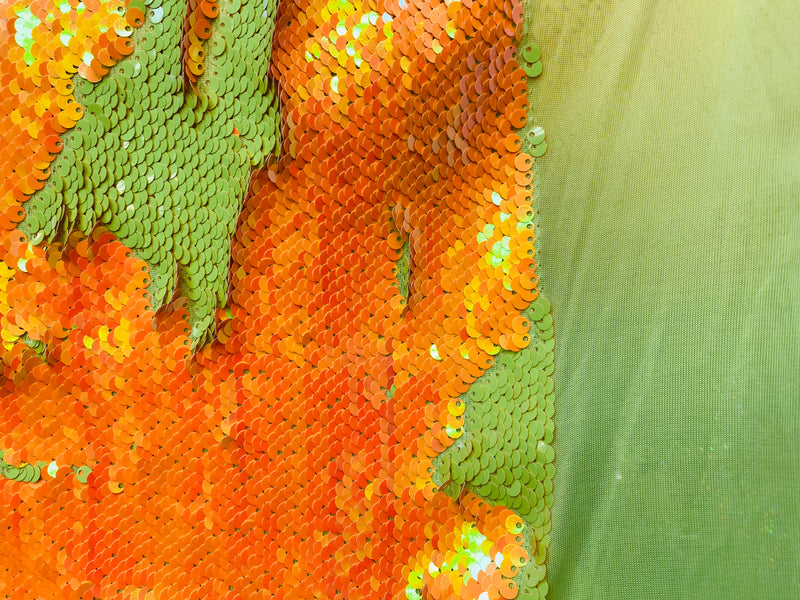 new iridescent neon orange  and iridescent neon yellow reversible sequin on one way stretch fabric 54inch wide sold by the yard