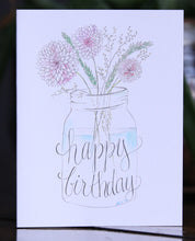 A mason jar filled with wildflowers. Happy Birthday... to you!