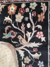 Hand-knotted artistic peacock and bird motif rug
