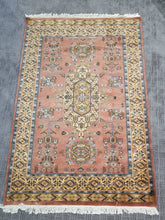 Pink and yellow hand-knotted rug