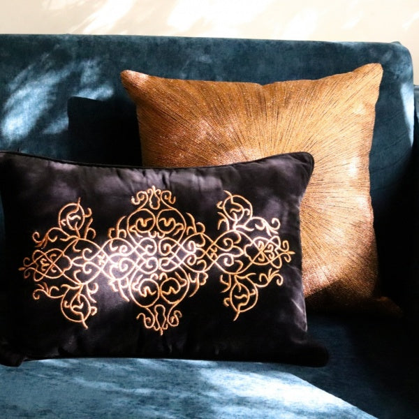 embroidered velvet cushions with a celtic pattern