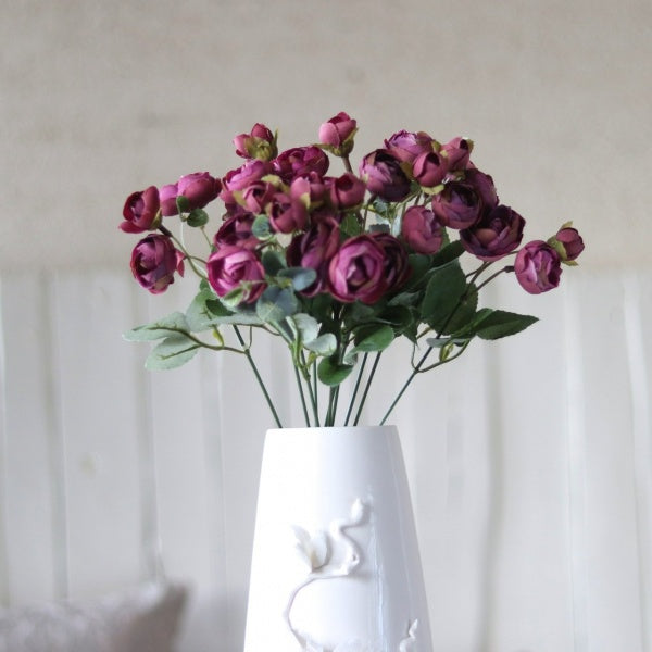 bunch of artificial nordic roses with stems