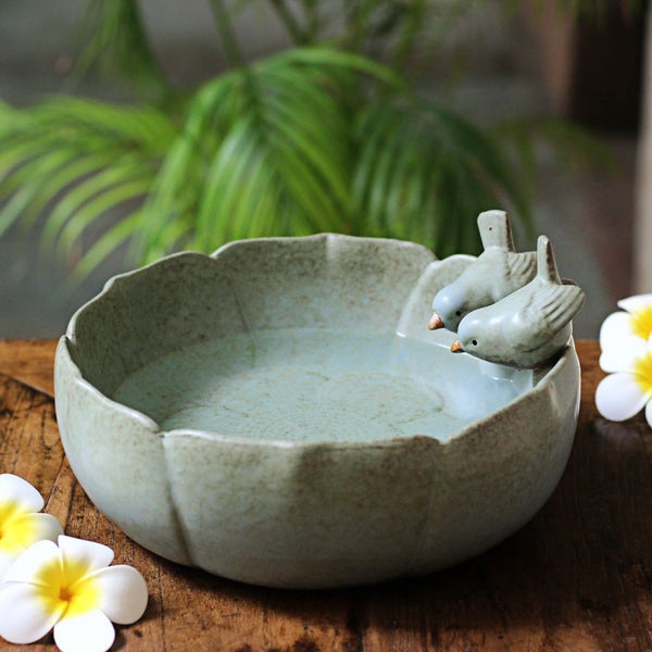 pale green ceramic urli with birds