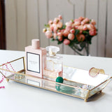 brass and glass vanity tray