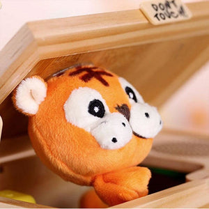 "Life will be boring without surprises. This little box will bring infinite fun to your family.  When you flip the ""do not touch"" button, a cute tiger will pop up with different performances and sounds."