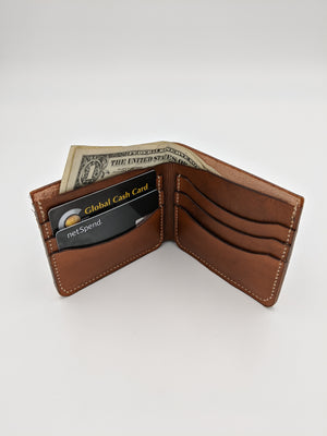 Handmade leather bi-fold wallet with carved floral design and horizontal card slots - RTS