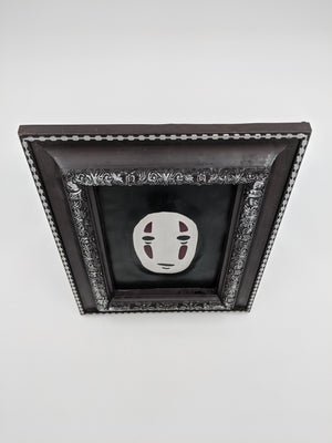 Leather art in frame, Kaonashi No-Face Manga embossed image
