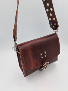 Leather saddle bag satchel with guitar strap style strap
