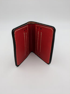 Leather folding wallet with Catwoman inspired design, card slots and billfold