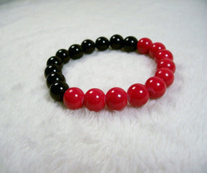 Red, Black and Orange Stretch Bracelet from Chained Dolls