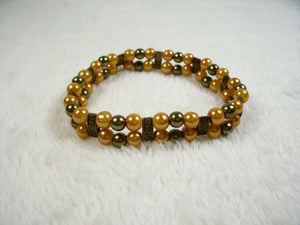 Gold and Bronze Two Strand Stretch Bracelet from Chained Dolls