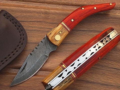 Damascus steel blade folding knife | Smith Online Studio.